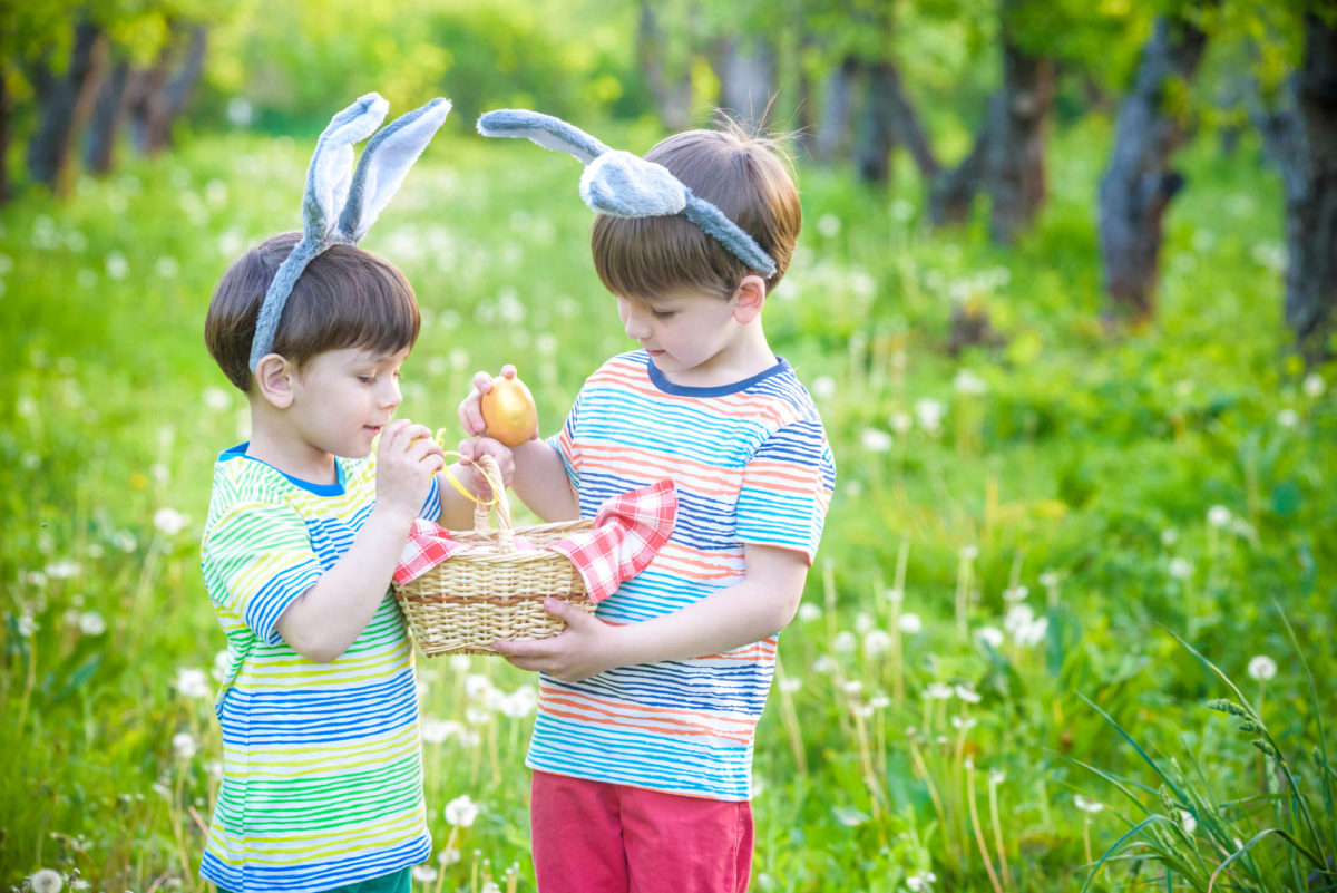 Boys hold basket while doing an Easter egg hunt - whats on in South Devon Easter