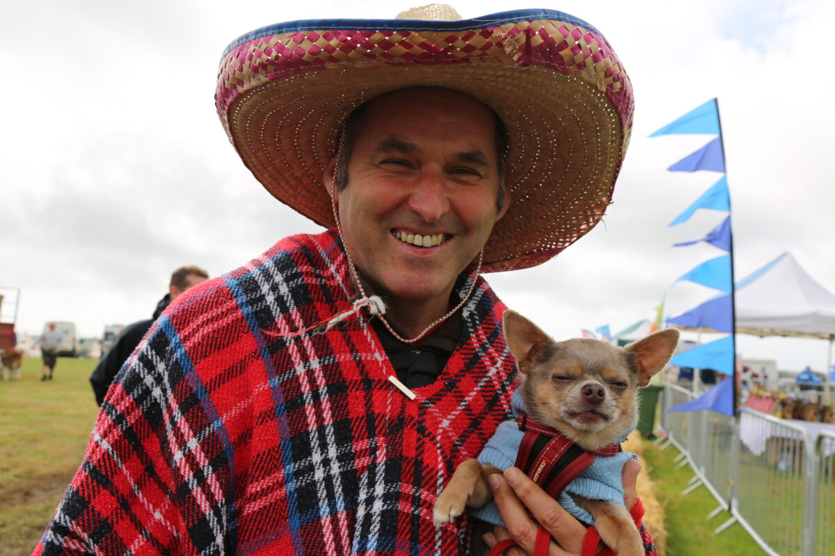 Dog and owner at Woofstock dog-friendly festival in Devon