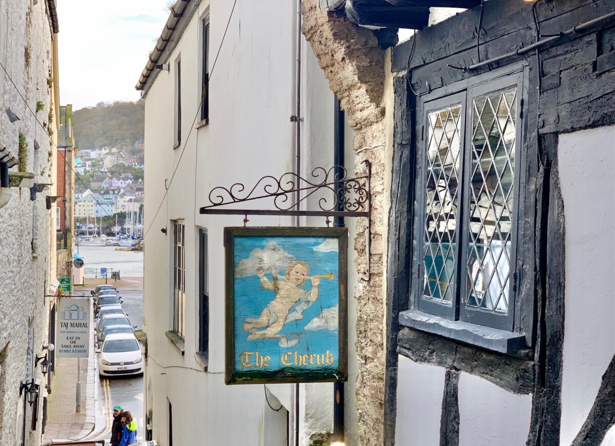 Sign for the The Cherub in a Dartmouth side street looking down to the river