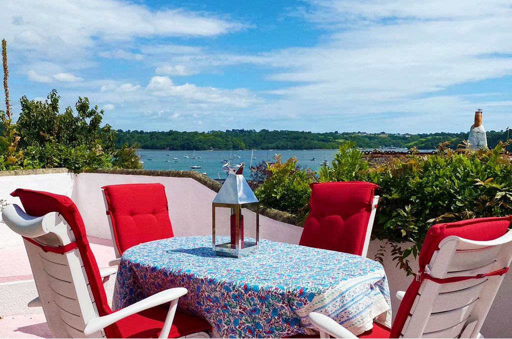 Table and terrace overlooking the River Dart at Crooks Cottage