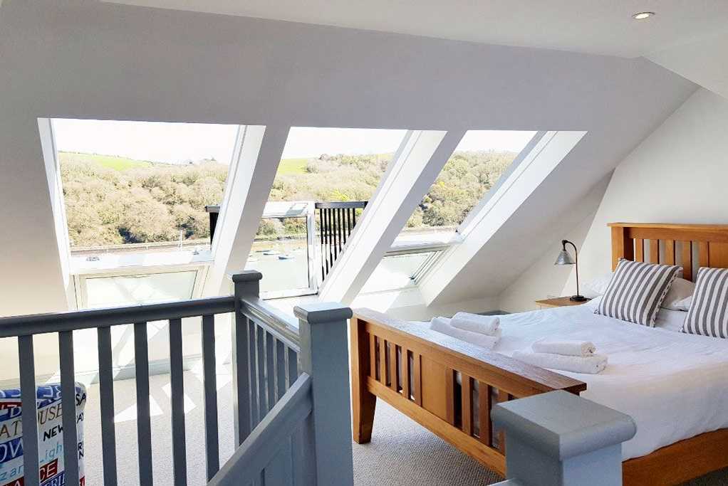 Large windows in sky room at Ferry View dog-friendly cottage in Dartmouth