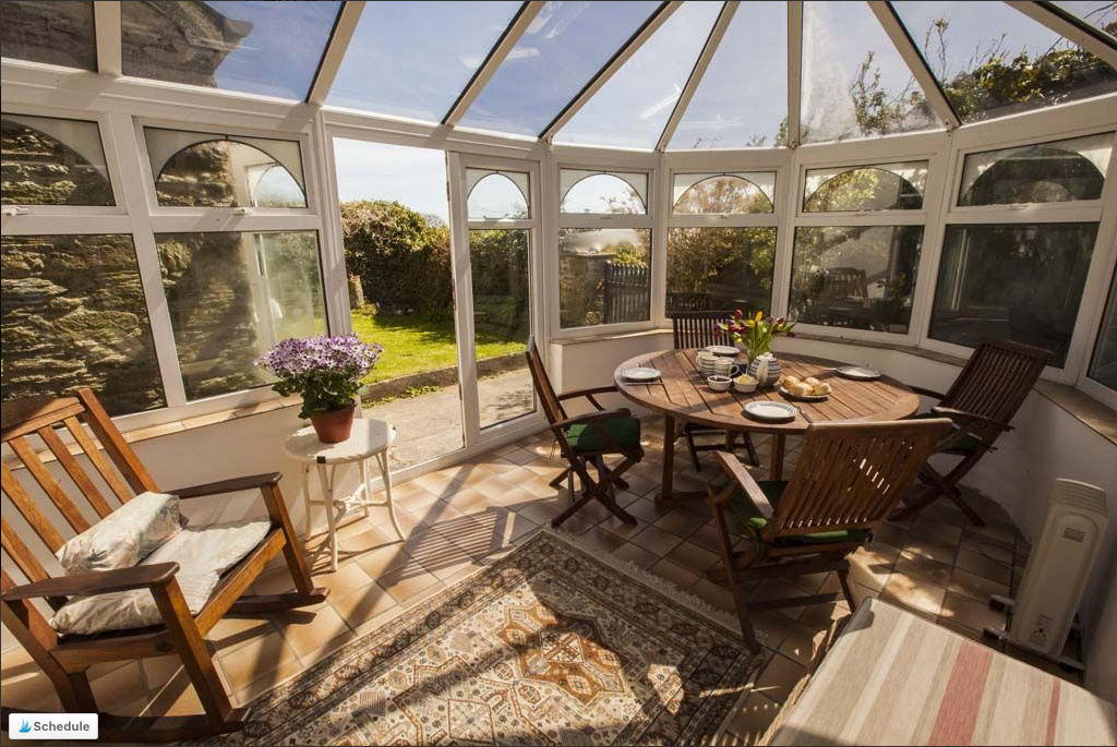 Conservatory overlooking garden at Lower House West holiday accommodation in Devon
