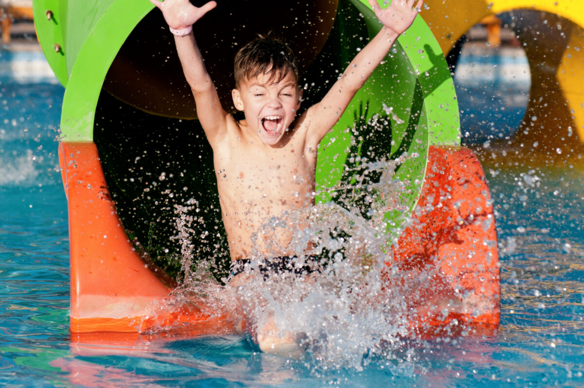 Boy on flume at water park